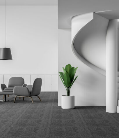 Interior of office lounge area with white walls, carpeted floor, gray armchairs standing near round coffee tables and stylish staircase. 3d rendering