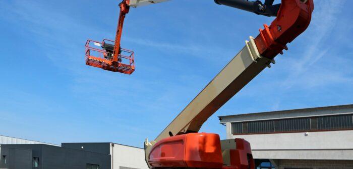 145169627 - aerial work platform in an industrial area. no people.